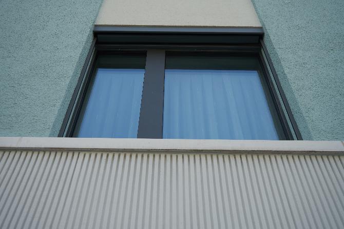 Fassade: Übergang vom Erdgeschoss zur Fassade (aus Putz)