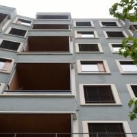 Fassade: Putzfassade mit farbigen Absetzungen (aus Putz)