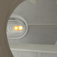 Erschliessung: Das Treppenauge von unten (aus Putz und Beton)